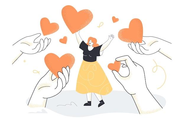 Mains donnant des coeurs à une petite femme heureuse