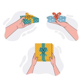 Mains donnant un coffret cadeau isolé sur fond blanc. illustration vectorielle