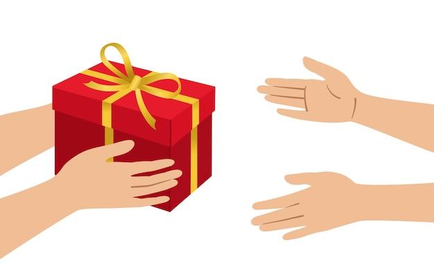 Les mains donnent une boîte rouge acceptent une boîte-cadeau de style dessin animé avec des arcs conteneur avec une décoration de ruban en or