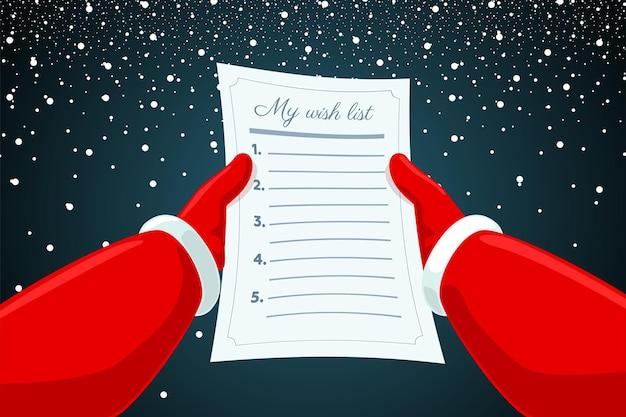 Mains du père noël tenant et lisant le papier de liste de souhaits de lettre sur fond neigeux noël et heureux