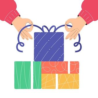 Mains emballant des coffrets cadeaux de noël préparation pour les vacances d'hiver
