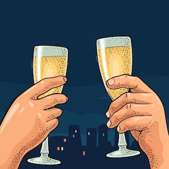 Mains féminines et masculines tenant et tinter des verres de champagne. gravure