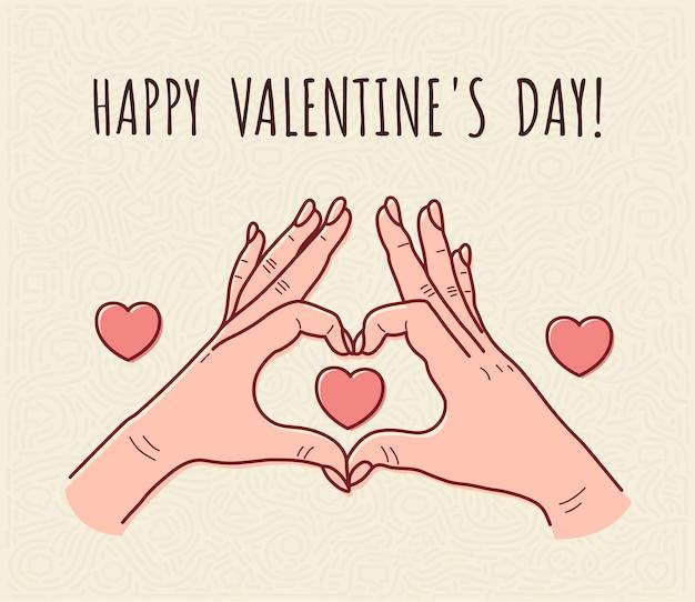 Les mains féminines montrent le cœur pour la saint-valentin