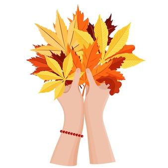Les mains des femmes tiennent un bouquet de feuilles d'automne. illustration vectorielle saisonnière.