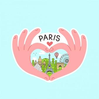 Les mains font le coeur avec paris à l'intérieur