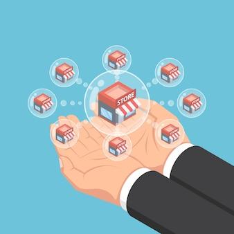 Mains d'homme d'affaires isométrique plat 3d tenant des bulles de réseau de magasins. concept de système d'entreprise de franchise.