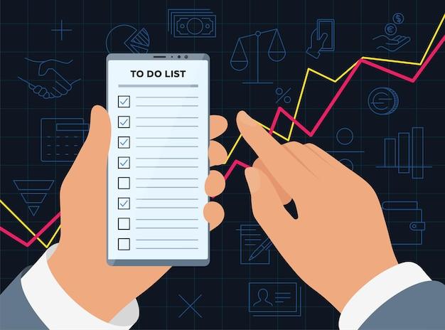 Les mains d'homme d'affaires tiennent le smartphone avec l'application de liste de contrôle sur l'écran d'affichage pour réussir