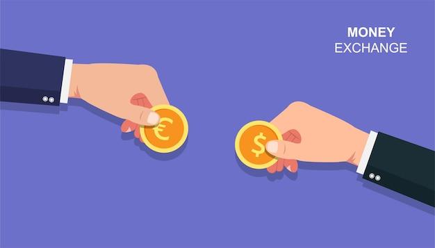 Mains d'hommes d'affaires tenant la pièce du concept euro et dollar. illustration de l'échange d'argent
