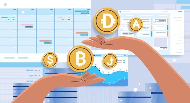 Mains humaines tenant le concept de crypto-monnaie de pièces d'or