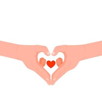 Mains jointes en forme de coeur.