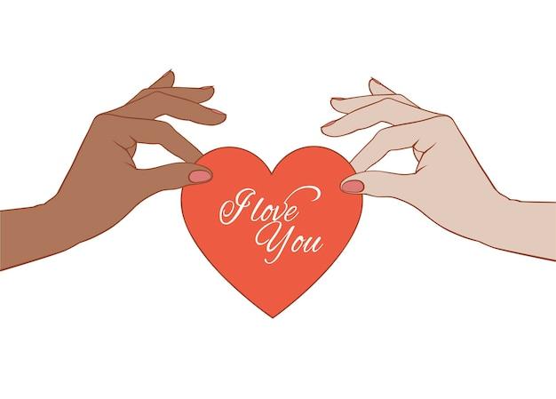 Mains noires et blanches tenant un coeur de la saint-valentin. carte de voeux saint valentin de style rétro