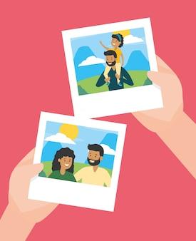 Mains avec des photos en famille