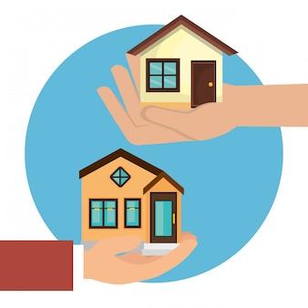 Mains soulevant l'icône de maisons