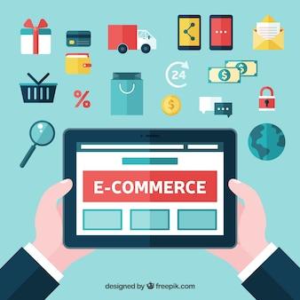 Mains avec tablette et achats en ligne