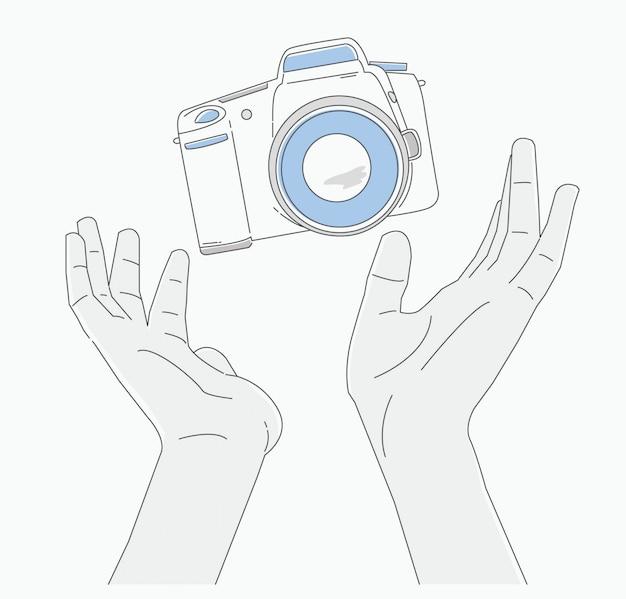 Mains tenant la caméra, journée de la photographie