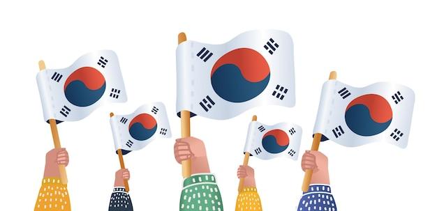 Mains tenant des drapeaux de la corée du sud corée du sud