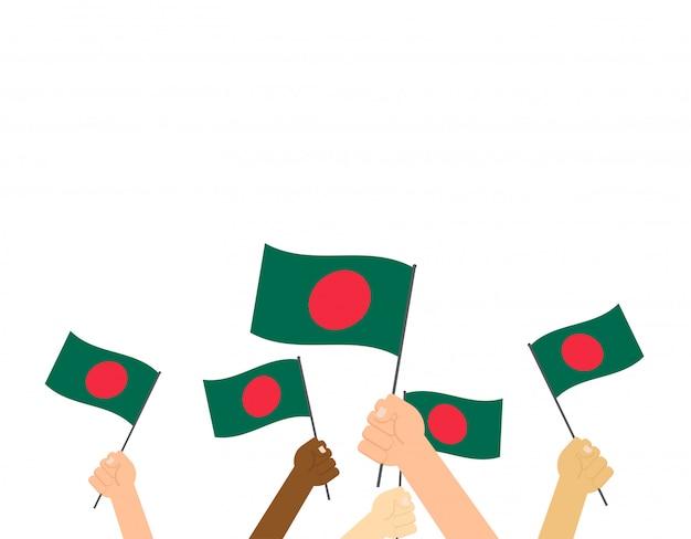 Mains tenant des drapeaux du bangladesh