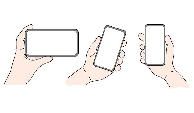 Mains tenant le smartphone