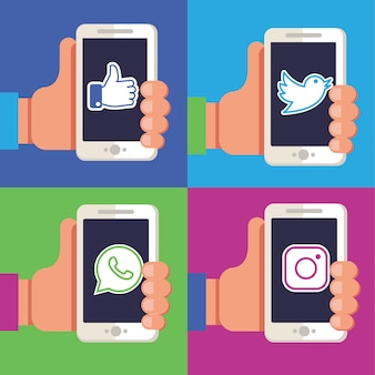Mains tenant des téléphones avec des applications de médias sociaux.