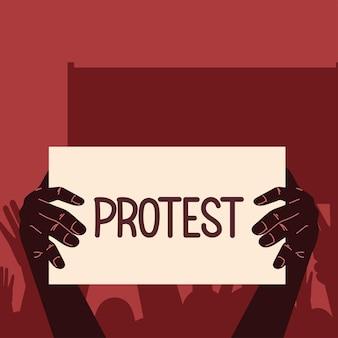 Les mains tiennent le lettrage de protestation