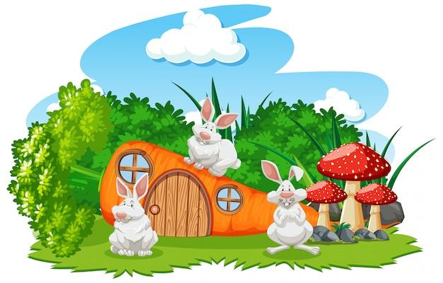 Maison de carotte avec trois souris style cartoon sur fond blanc