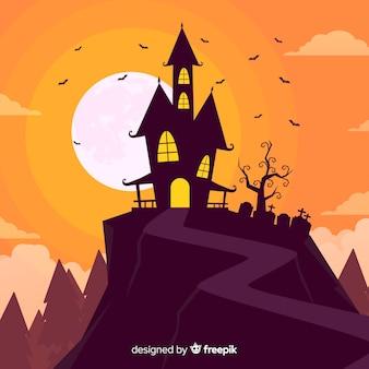Maison sur une colline au crépuscule fond d'halloween