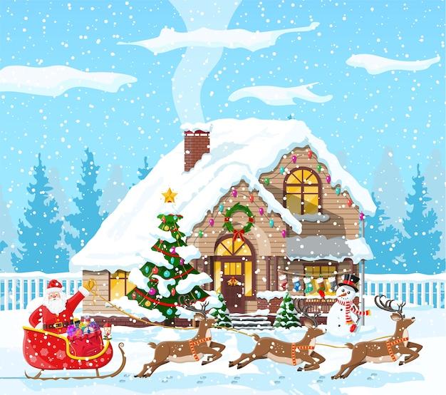 Maison couverte de neige avec thème de noël