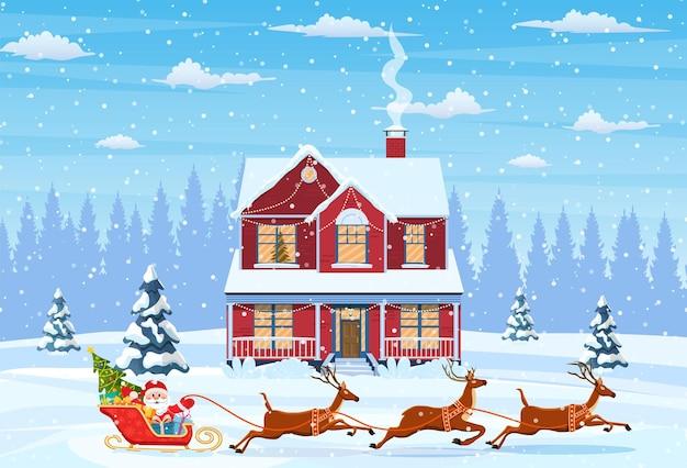 Maison dans le paysage de noël enneigé