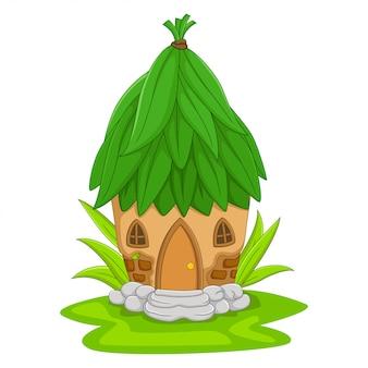 Maison de fée de dessin animé avec un toit de feuilles