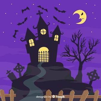 Maison et fond d'halloween lune contrariée