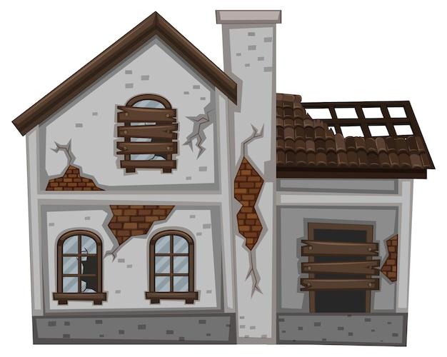 Maison grise aux murs en ruine