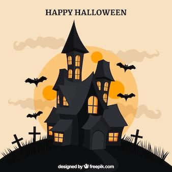 Maison de halloween, chauves-souris et pleine lune