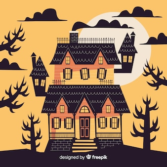 Maison d'halloween hantée au coucher du soleil