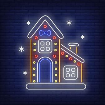Maison en pain d'épice avec des flocons de neige dans le style néon