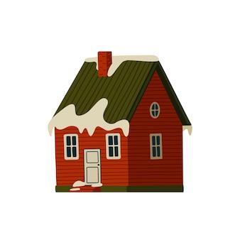Maison rouge dans les montagnes enneigées
