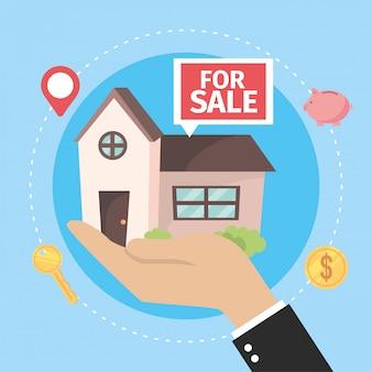Maison à vendre à la main d'homme d'affaires
