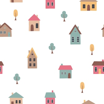 Maisons et arbres mignons dessinés à la main dans un style plat