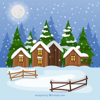 Maisons en bois enneigés
