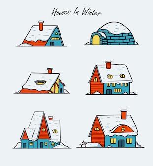 Maisons d'hiver couvertes de jeu d'illustration de neige