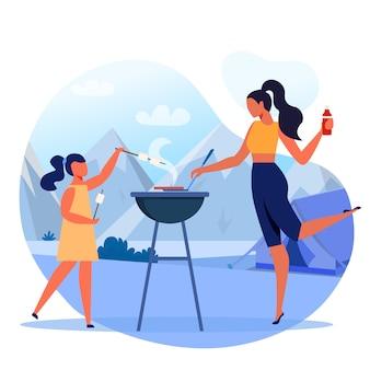 Maman avec enfant sur plat pique-nique