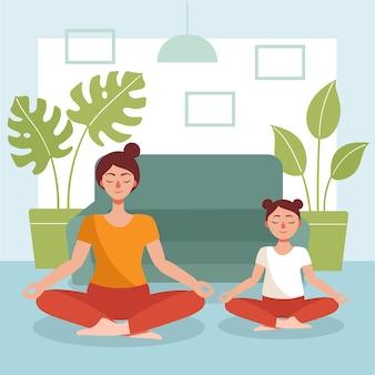 Maman et sa fille font du yoga à la maison