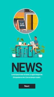 Man holding journal lire les nouvelles quotidiennes sur la quarantaine des coronavirus est sur l'espace de copie pleine longueur