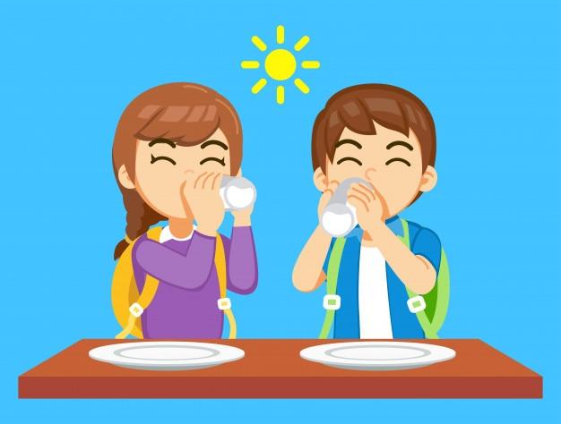 Manger et boire du lait avant d'aller à l'école.