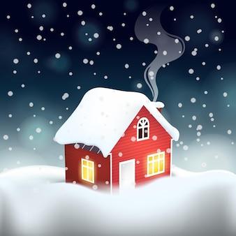 Manoir en bois rouge suédois avec toit couvert de neige en hiver