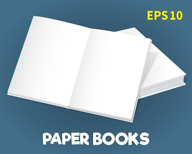Une maquette de deux livres de papier blanc posée sur la table.