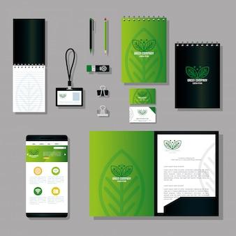 Maquette fournit des articles de papeterie de couleur verte avec des feuilles de signe, une identité verte d'entreprise