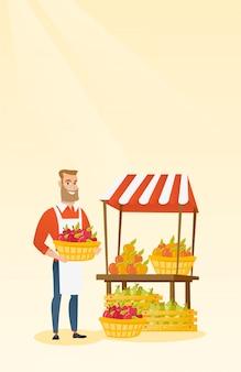 Marchand de légumes tenant une boîte pleine de pommes.