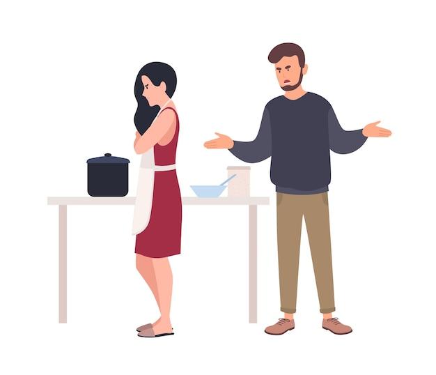Mari criant à sa femme pendant qu'elle cuisine dans la cuisine
