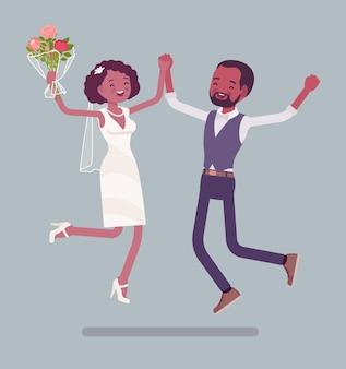 Les mariés heureux sautent sur la cérémonie de mariage