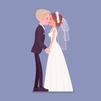 Les mariés s'embrassent lors de la cérémonie de mariage